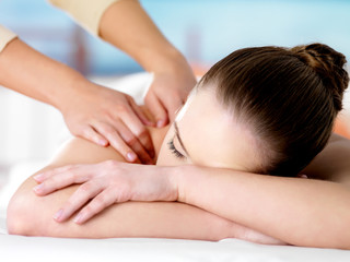 Woman relaxing on spa massage