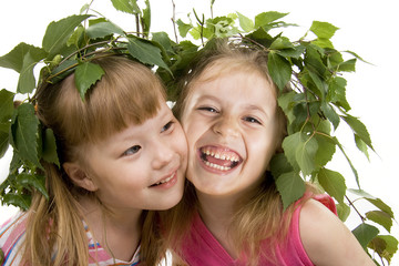 Two cheerful little girls of the friend on a white background