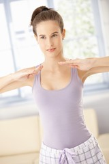 Energetic woman exercising in morning
