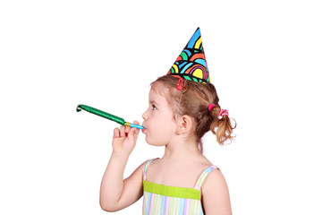little girl with birthday hat and trumpet party