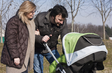 Happy Family Walking with Stroller