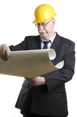 Senior architect looking at blueprints