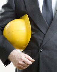 Construction hat under arms