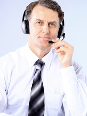 business man wearing glasses and headset