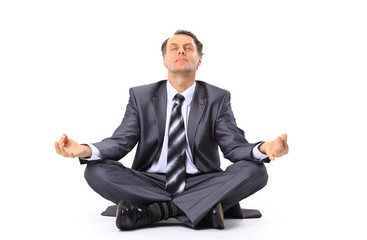 relaxed businessman meditating isolated on white
