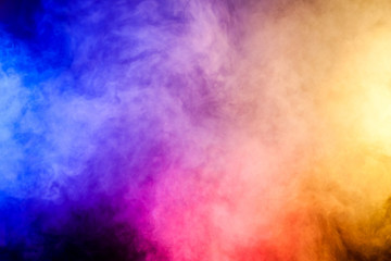 Red, Yellow and blue smoke  on black background