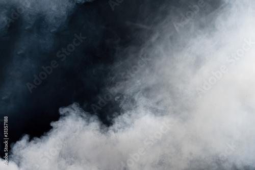 Leinwandbild Motiv White smoke on black background. Isolated.