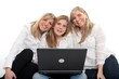 Smiling girls with laptop