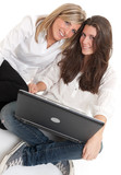 Young female friends with laptop