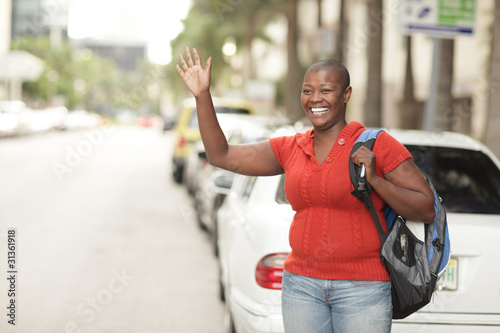 Woman waving across the street