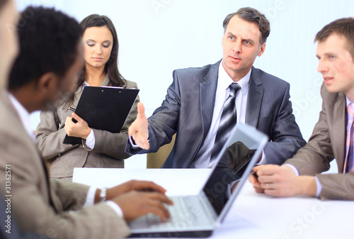 Portrait of senior business man discussing a new