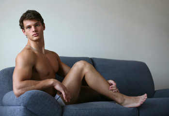 Young Sexy Man on a Sofa