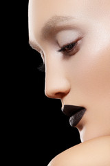 Fashion model with black lips make-up, perfect skin