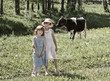 Country little girls and cow