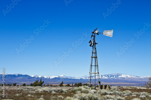 Broken-Down Windmill On Desert Farm