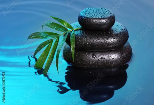 Leinwandbild Motiv Spa still life with stone pyramid reflecting in water