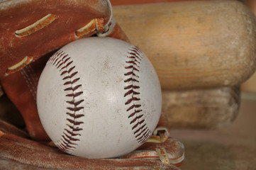 Old Baseball in Glove