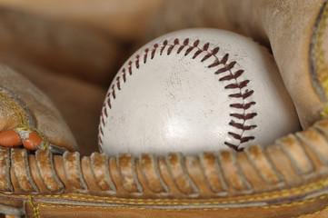 Old Baseball in Catcher's Mitt