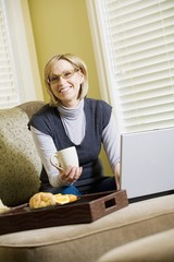 Woman Working On Laptop Computer From Home