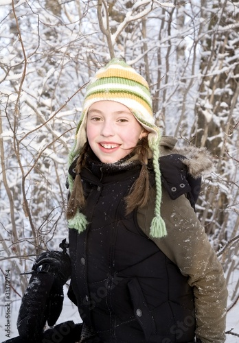 Portrait Of Girl In Winter Clothing