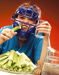 Woman In Sports Equipment Eating Celery