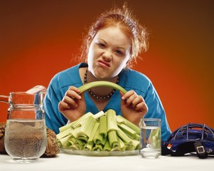 Women With Plate Of Celery And Sports Equipment