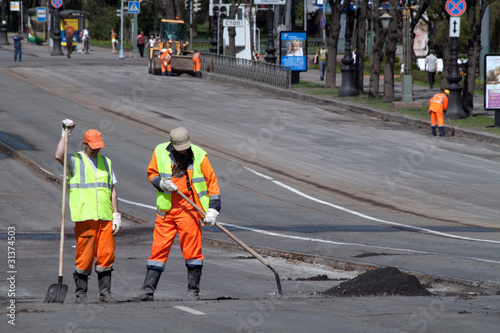 Road workers with shovels