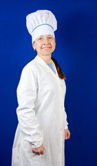 Senior cook woman in toque