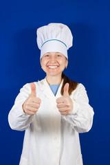 Senior cook woman in toque