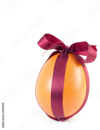 Easter egg, decorated a brown ribbon