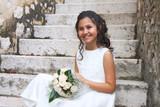 Smiling girl in white dress