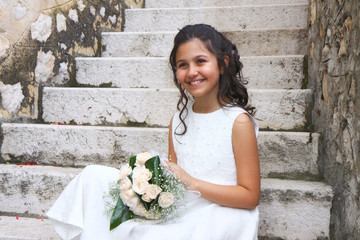 Smiling girl in white dress