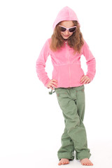 Young girl standing in pink top and green pants