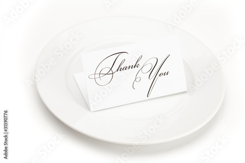 plate with card signed thank you isolated on white