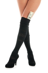 female legs with dollar banknotes