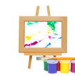 Frame on an easel , colorful paint buckets and paintbrush