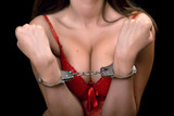 sexy woman in red lingerie handcuffed