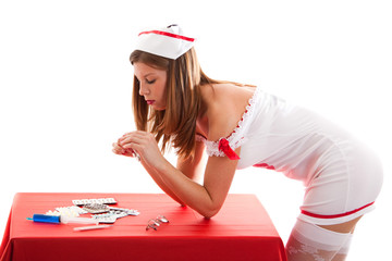 Young sexy nurse with medicaments