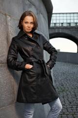 Beautiful woman near stone wall