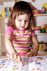 Little Girl Learning Figures and Letters