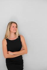 Beautiful businesswoman standing on grey background