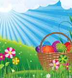Basket with eggs on to the meadow. Easter landscape