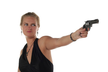 young blond woman in black dress with revolver isolated