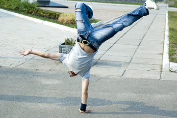 Guy dancing break-dancing in the street