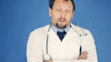 Unhappy doctor with crossed hands, on blue background