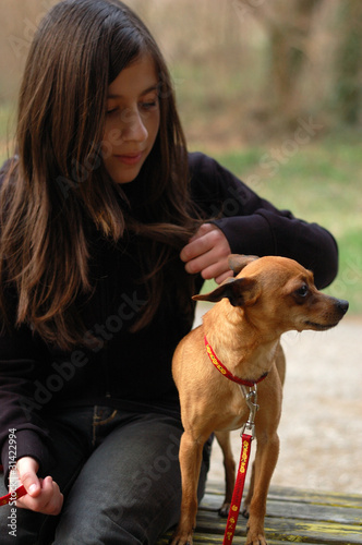Teen girl with a small dog