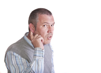 Portrait of middle aged caucasian man holding his ear to listen