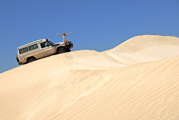 Woman With Off Road Car On Sand Dunes