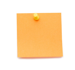 Orange post-it with drawing pin