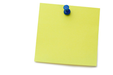 Yellow post-it with drawing pin